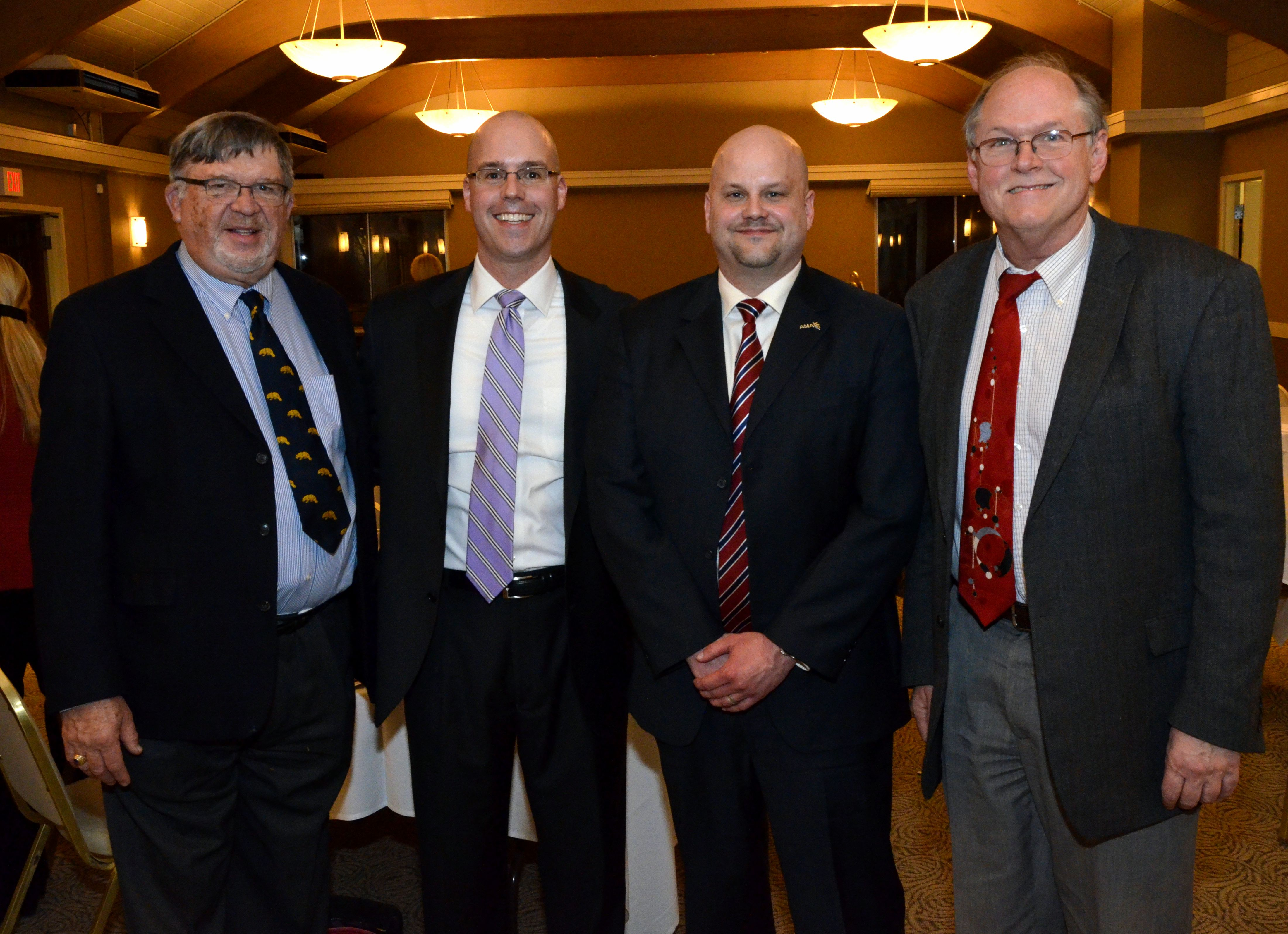 WCMS Past President Charles F, Koopmann, Jr., MD; AMA President-Elect Steven Stack, MD; President-Elect Brad J. Uren, MD, and President Larry Junck, MD